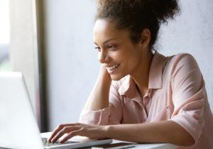 Smiling woman browsing on net